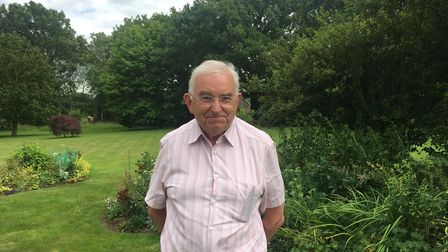 Malcolm Wood, in his garden in Longham, near Dereham, wants to thank the doctor who saved his life n