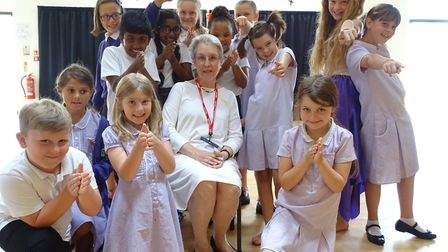 Connie Forsyth, centre, pictured with Queen's Hill Primary School pupils. Picture: Lauren Forrest