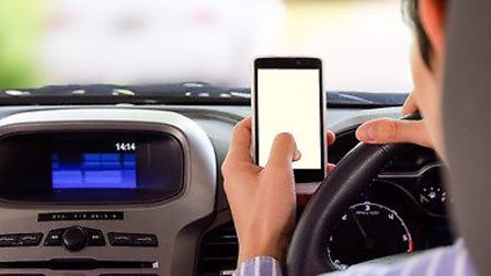 Police have launched a fresh crackdown on drivers who use mobile phones. Picture: Archant Library