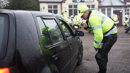 Norfolk Police stopping drivers who are using mobile phones along Yarmouth Road in Norwich. Picture: