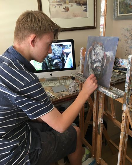 Kieron Williamson, painting in his studio. Picture: Submitted