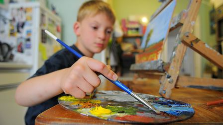 Kieron then aged just seven painting in his studio. Picture: James Bass