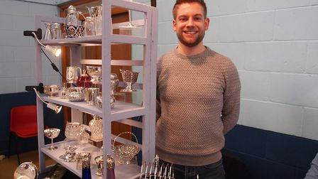 Andy Cox, 29, who sells silver items at the Hingham Antiques Fair. Picture: Courtesy the Hingham Ant