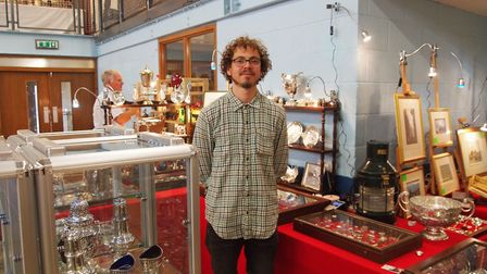 Tolly Isgrove, 24, of Greenfinch Antiques, who sells silver itesm and art at the Hingham Antiques Fa
