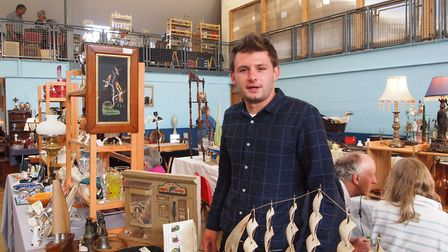 Tom Boynton, 23 who sells miscellaneous decorative items at the Hingham Antiques Fair. Picture: Cour