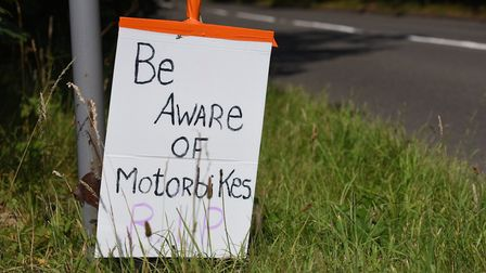 A sign left at the scene encourages drivers to be aware of motorbikes. Photo: Nick Butcher