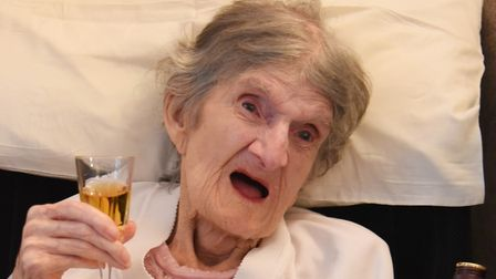 Kathleen Atthill celebrating her 104th birthday with a tot of Bell's Whisky at the St Clements Nursi