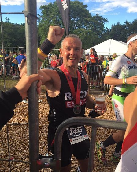 Mr Chilvers celebrates after crossing the finishing line. Photo: Jo Chilvers