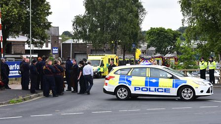 Emergency services and staff at Spar Road, Norwich after the reported explosion and fire believed to