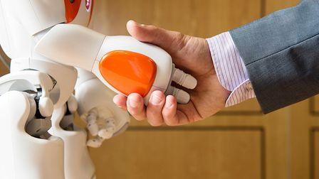 File photo of a robot shaking hands. Picture: Nic Delves-Broughton/PA