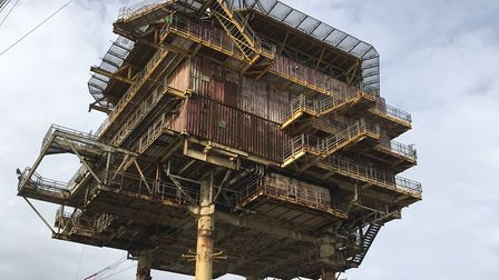 The topside of the Shell Leman BH platform being lowered into position at Great Yarmouth for decommi