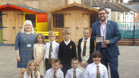 Governor James Wright with headteacher Maria Grimmer and pupils. Picture: St Nicholas Priory School