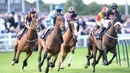 First-bend action from the 3.10pm race, won by Avenue Des Champs.Picture: Nick Butcher