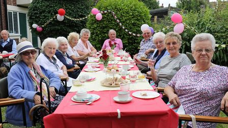 Residents of Norwich Housing Society's Eleanor Road complex enjoying the strawberry tea party. Pictu