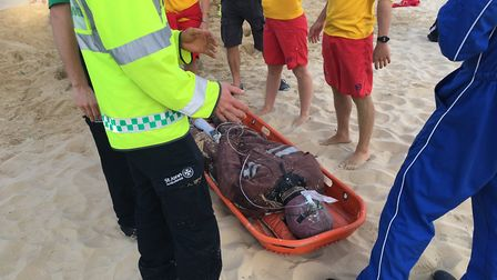 Emergency services rescue a dummy buried to in the sand as part of a sand hole collapse exercise. Ph
