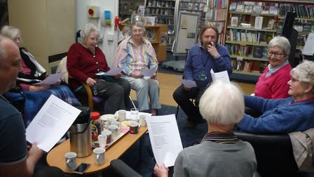Visitors to Taverham Library enjoying a shared reading event as part of Norfolk County Council's In