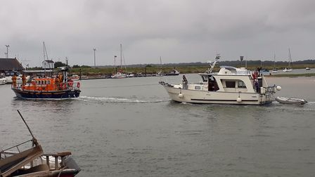 Cabin Cruiser, Sea Mist, being towed on to the Quay by Wells Lifeboat. PIC: Supplied by Wells Lifebo