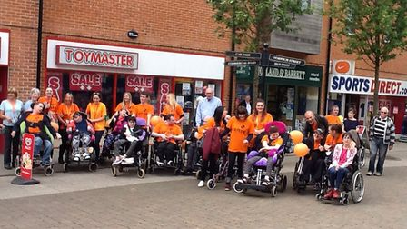 People from Dereham took part in a walk to raise awareness of disabled people in the community. Pict