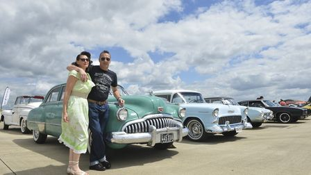 A couple poses in front of their classic car during the Wings and Wheels event at RAF Lakenheath to