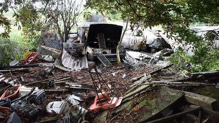 The aftermath of the fire at Hapton where several vehicles were set on fire on a closed off piece of
