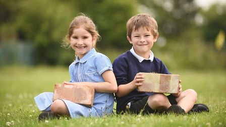 Harpley Primary School are trying to raise money for a new classroom. Pictured are Eva Darlow and Ha