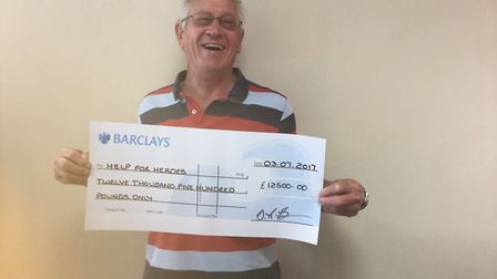 David Brown with his help for heroes cheque. Picture: Courtesy of David Brown.