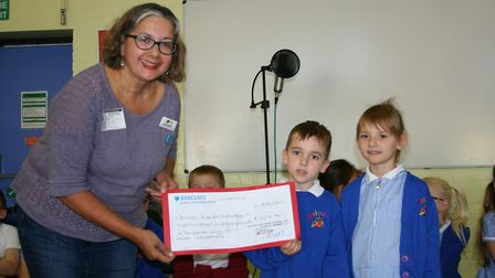 Bonita Johnston, from the British Trust for Ornithology (BTO), receiving a cheque from Jamie Bates