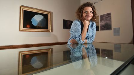 Giorgia Bottinelli, curator of historic art at the Castle Museum, pictured with the Magritte paintin