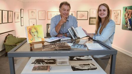 Artist John Christie and Mandell's Gallery manager, Rachel Allen, with the exhibition Seeing Through