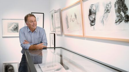 Artist John Christie at the exhibition he proposed to put together, Seeing Through Drawing, A Celebr