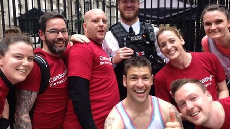 David Tuthill, second left, joins Chris Morley and other supporters on a 5km run in London earlier t