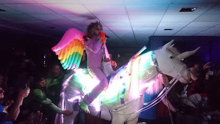 Wayne Coyne of The Flaming Lips riding a unicorn around the LCR. Photo: Annie Catwoman