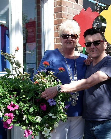 Town reeve Mary Sprake and Bungay in Bloom chairman Simon Thompson with one of the baskets. Picture:
