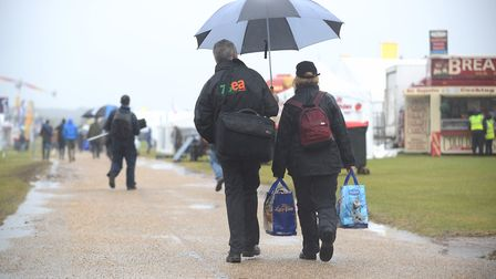 Early visitors braving the rain at the Royal Norfolk Show. Picture: Ian Burt