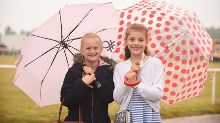 Annabelle Royal (10) and Alice Marjoram (10) braving the rain at the Royal Norfolk Show. Picture: Ia