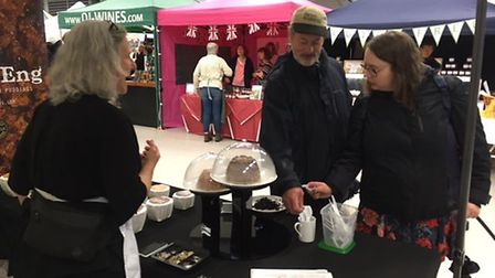 Kate Lyons introduces some show visitors to her range of puddings. Picture: Andrew Stone