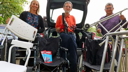 David Potten of PhysioNet (centre) collecting redundant mobility equipment from Norwich Housing Soci