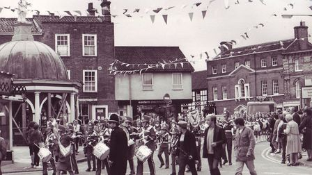 Bungay hog fair carnival procession making its way past the historic Buttercross, dated September 3,
