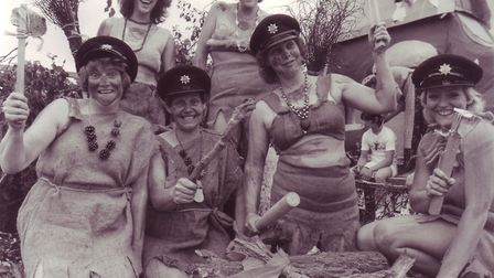 Bungay fire service women show their cavewoman ferocity from their float in the Bungay hog fair proc
