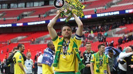 The good times - Russell Martin lifts the Championship play-off final trophy at Wembley. Picture: P