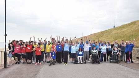 Funracing relay at Gorleston with Special Olympics athlete Ricky Brown (pictured centre in light blu