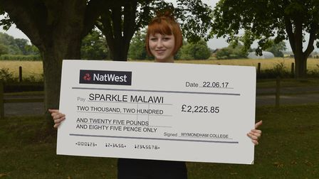 Wymondham College student Dorrie Hartley with a cheque for the charity Sparkle Malawi. Picture: Wymo