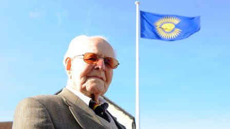 John Howes, as a 100-year-old FEPOW raising the Commonwealth flag at the Cliff Hotel, Gorleston to m