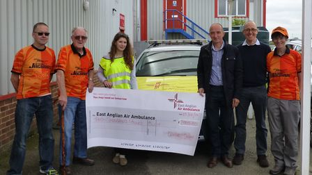 Members of Coltishall Jaguars Running Club committee hand over a cheque for �2000 to the East Anglia
