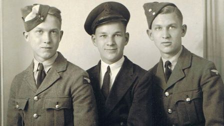 Jim Bowles, centre, with brothers Harry, left, and Jack, in 1942. Picture: Courtesy the Jim Bowles f