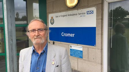 Town councillor David Russell outside the Cromer ambulance station. Pictures: David Bale