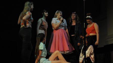 Michaela Rudling, centre, performing a number from Grease at a previous showcase. Picture: Open