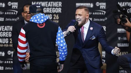 Conor McGregor, right, taunts as Floyd Mayweather during a 'news conference' in Los Angeles. Picture