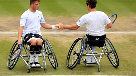 Alfie Hewett and Gordon Reid celebrate winning a point during their victory over Nicolas Peifer and