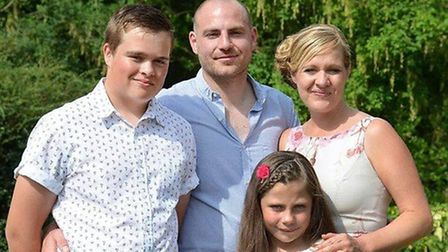 Mark Hawkins with wife Victoria, son Max and daughter Izzy. Photo: Nelson's Journey
